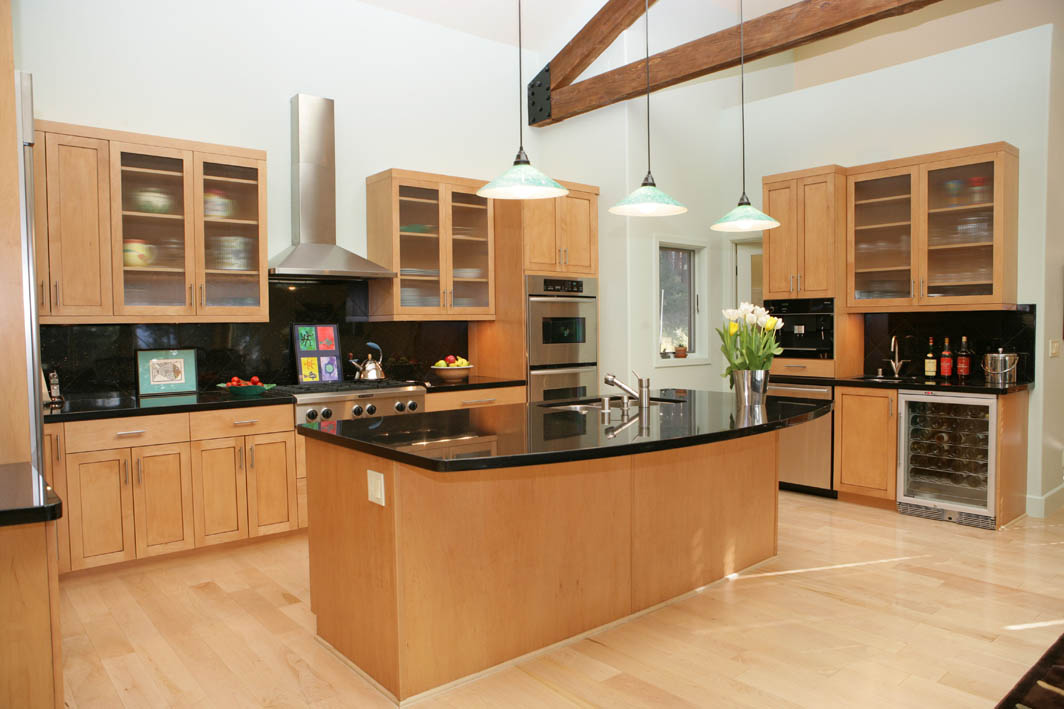 Modern kitchen with dark granite and light maple cabinets for Kitchen gallery